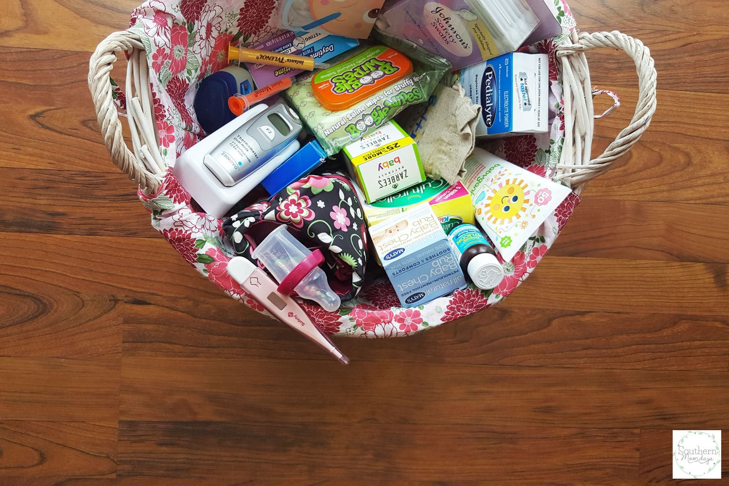 Basket full of items for your baby registry and starter medicine cabinet for baby's first year, featured on the Southern Momdays blog