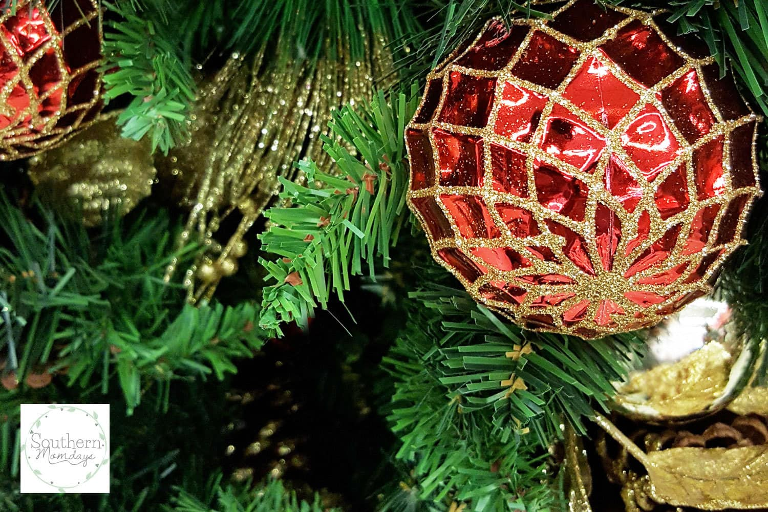 Red and gold Christmas ornaments on tree in How to Save for Christmas (the Easy Way), featured in a holiday budget guide on the Southern Momdays blog