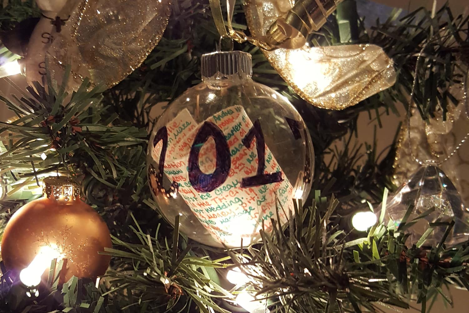 The Unforgettable Year-in-Review Christmas Ornament Tradition That My Husband Loves, featured on the Southern Momdays blog