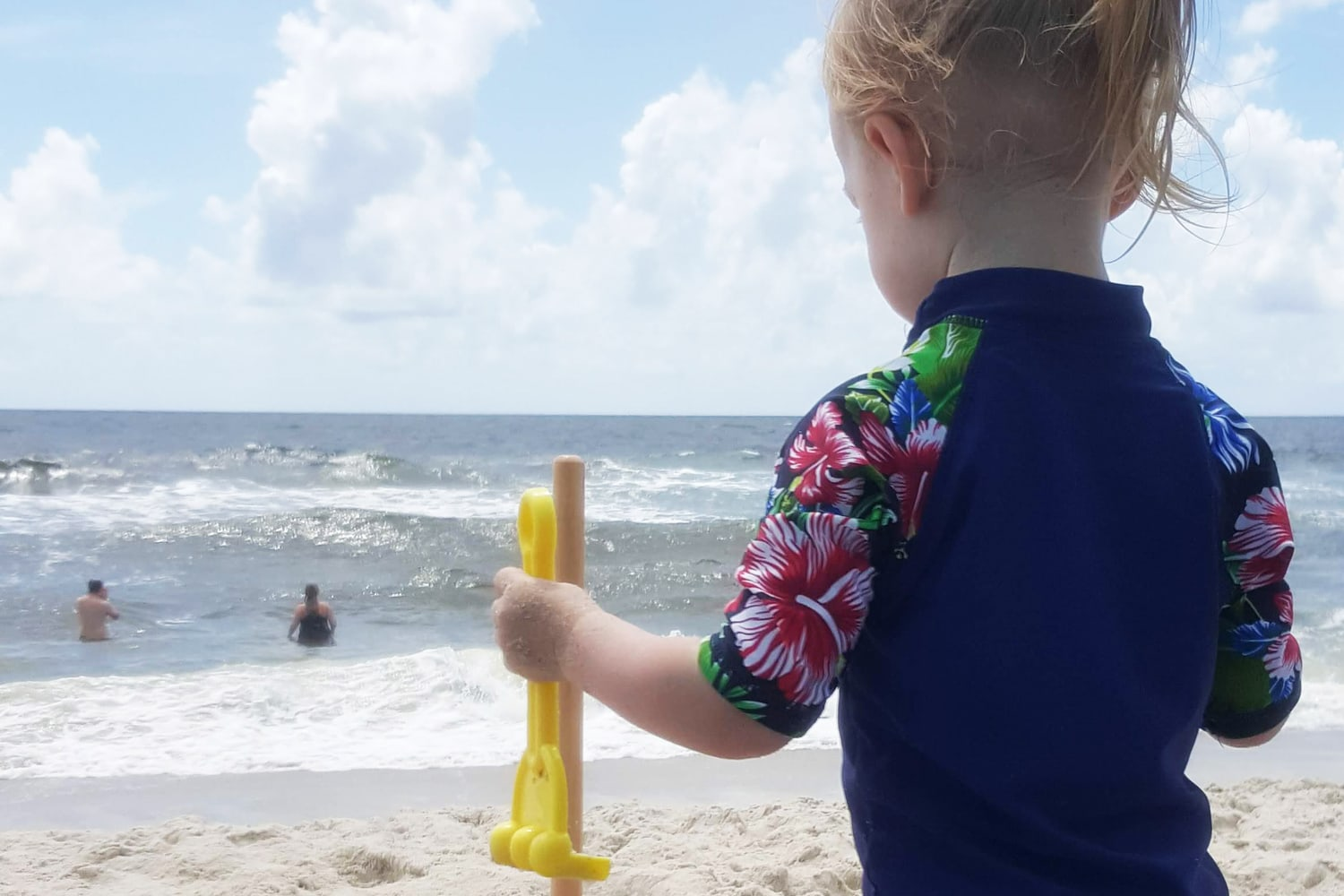 Toddler Beach Tips: 5 Beach Packing List Essentials, with featured image of toddler playing in sand on the beach, by Southern Momdays